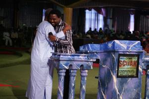 TB Joshua and Atta Mills in a warm embrace