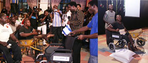 TB Joshua with one of the physically challenged, who received N100,000 and a new wheelchair...