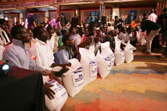Every single attendee receives a bag of rice and cash support...