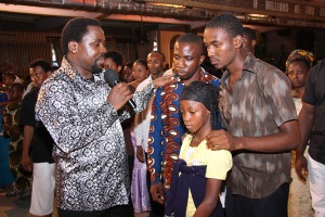 TB Joshua with Favour and family