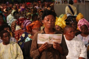 Mrs Tokunbo displays the pictures of her husband's corpse