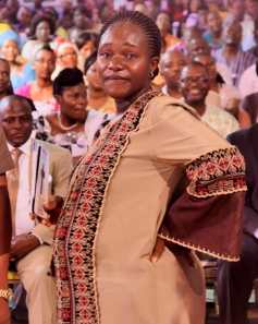 Mrs Stanley Igwe joyfully testifying to the congregation.